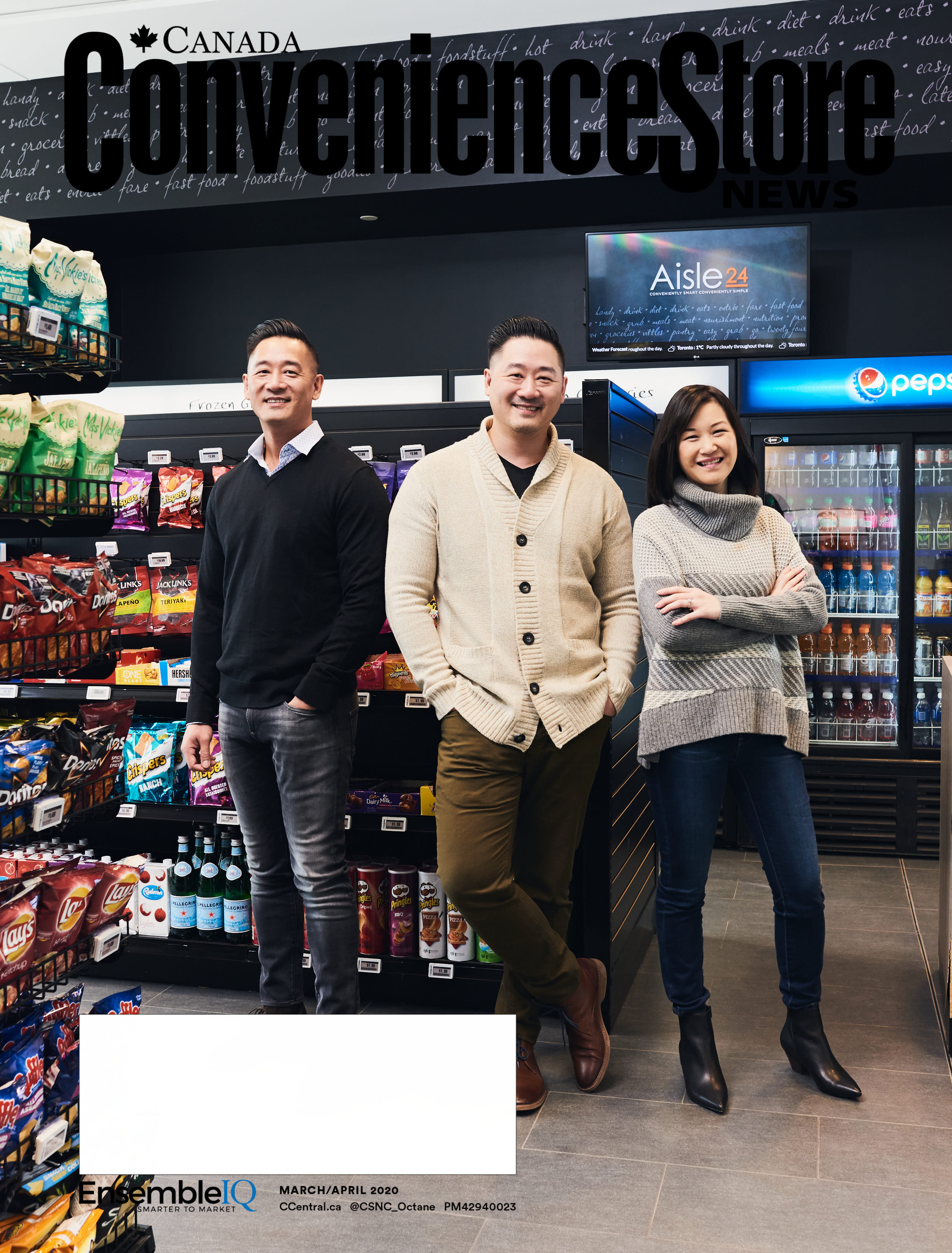 Three young smiling business people standing in convenience store