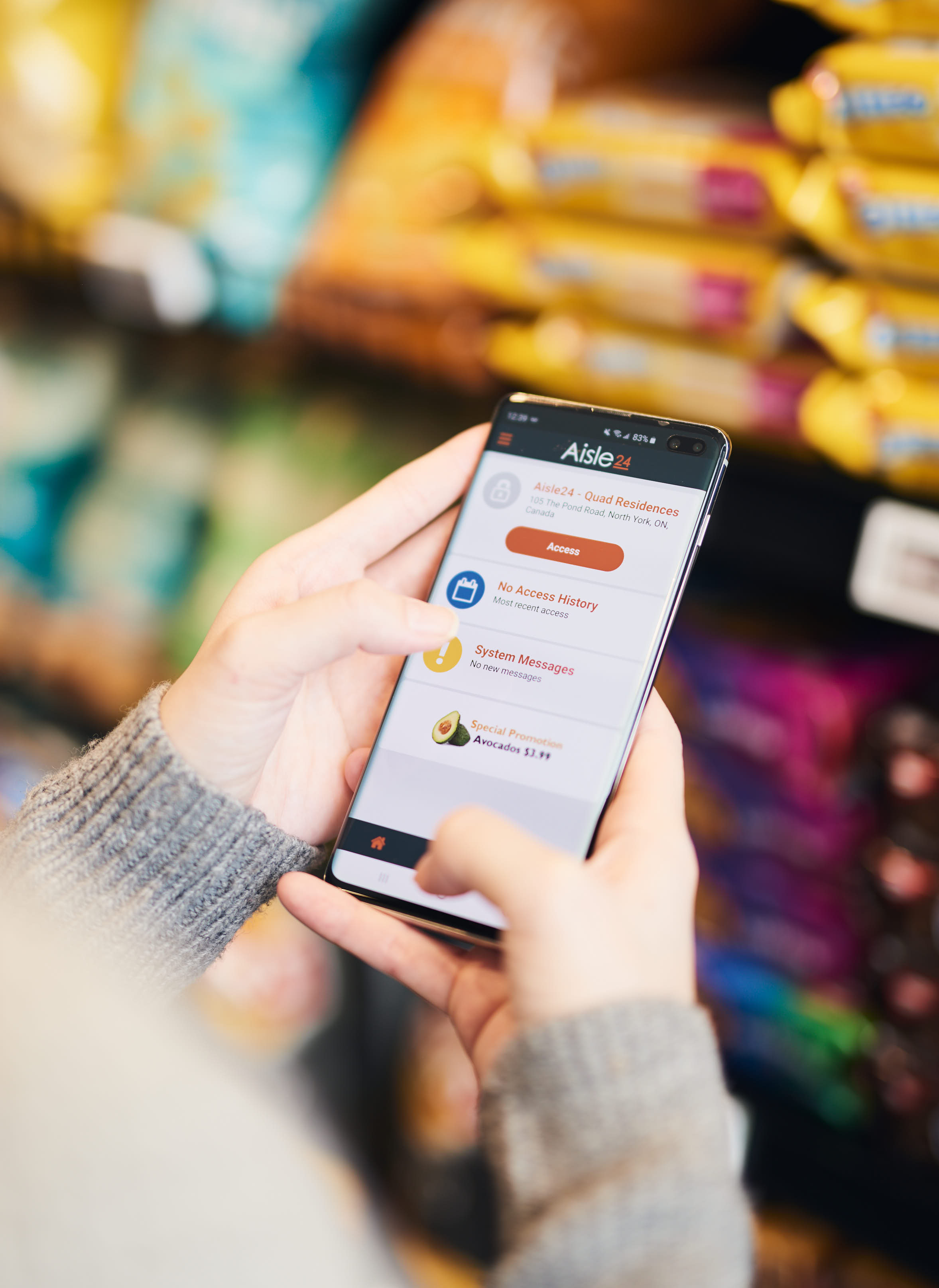 Close-up of hands holding purchasing app in convenience store