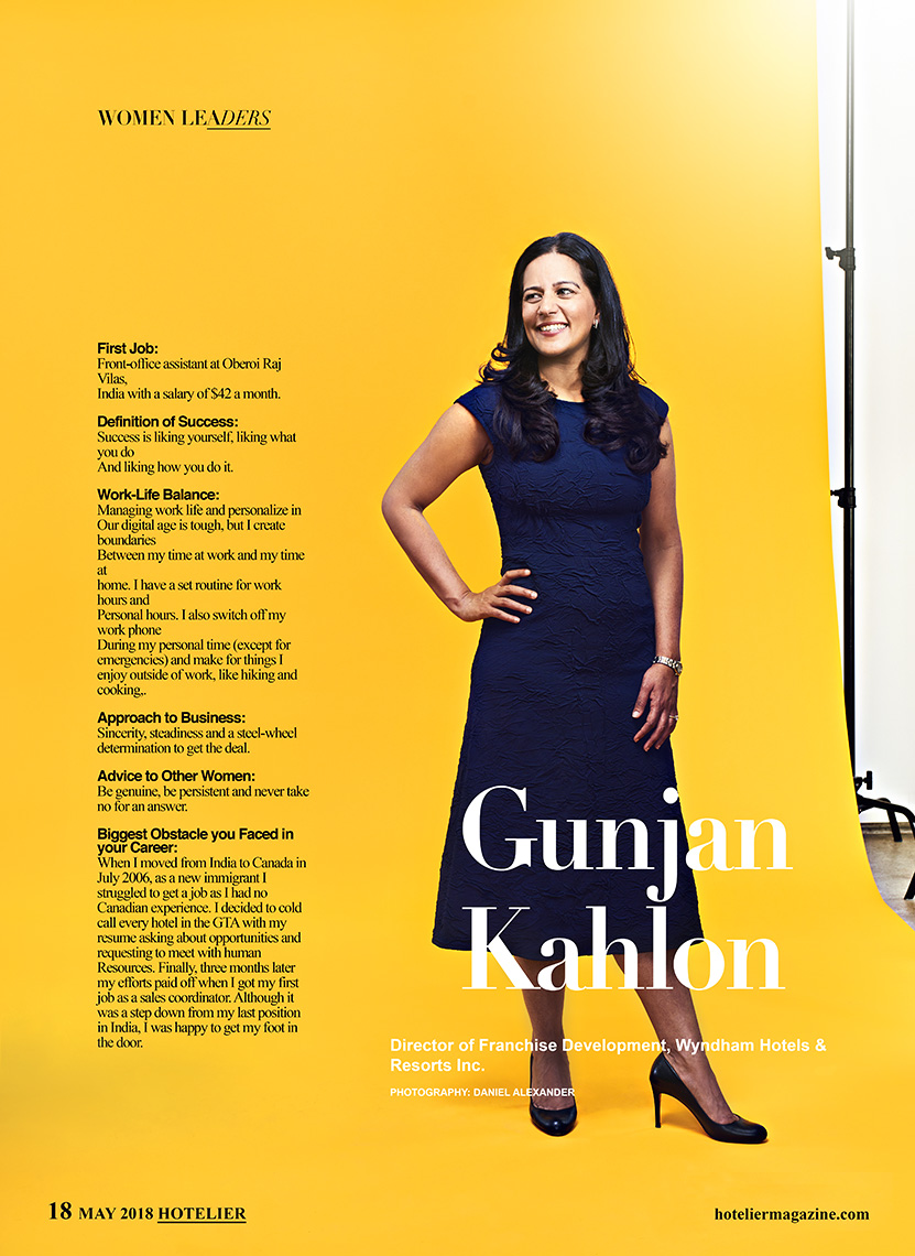 Full length studio photograph of business executive on bright yellow background for Hotelier Magazine